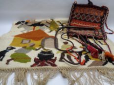 TRIBAL WOOLWORK WALL HANGING, vintage carpet type bag and a leather whip, 120 x 84cms the wall