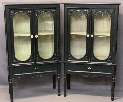 ANTIQUE STYLE EBONISED TWIN-DOOR DISPLAY CABINETS, A PAIR - having bevel edged glass and pottery