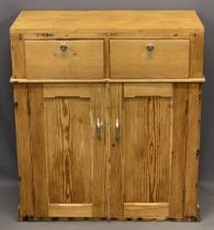 STRIPPED PINE VINTAGE CUPBOARD having two upper drawers and twin lower cupboard doors, 85cms H,