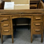 CIRCA 1900 OAK ROLL TOP DESK and a boxed ceiling fan, the desk tambour requiring restoration, 107cms