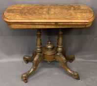 VICTORIAN WALNUT FOLDOVER CARD TABLE - on turned and carved supports and central urn finial on brown
