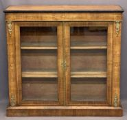 CIRCA 1850 INLAID WALNUT TWO DOOR SIDE CABINET - with brass embellishments on a plinth base, 99cms