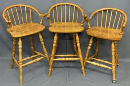 MODERN STOOLS - set of three lightwood with bow and spindle elbow backs