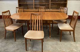 G-PLAN DINING TABLE & SIX CHAIRS - light wood, the table extending with flip-out leaf, 73cms H,