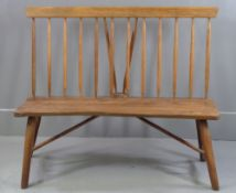 RUSTIC BENCH with walnut seat and spindleback, 108cms H, 127cms W, 47cms D