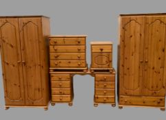 MODERN PINE BEDROOM FURNITURE comprising two wardrobes, one with base drawer, both 178cms H, 87cms