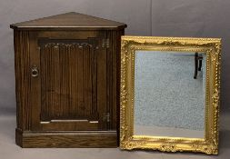 LINENFOLD CARVED FLOOR STANDING CORNER CUPBOARD and a modern gilt framed wall mirror with bevelled