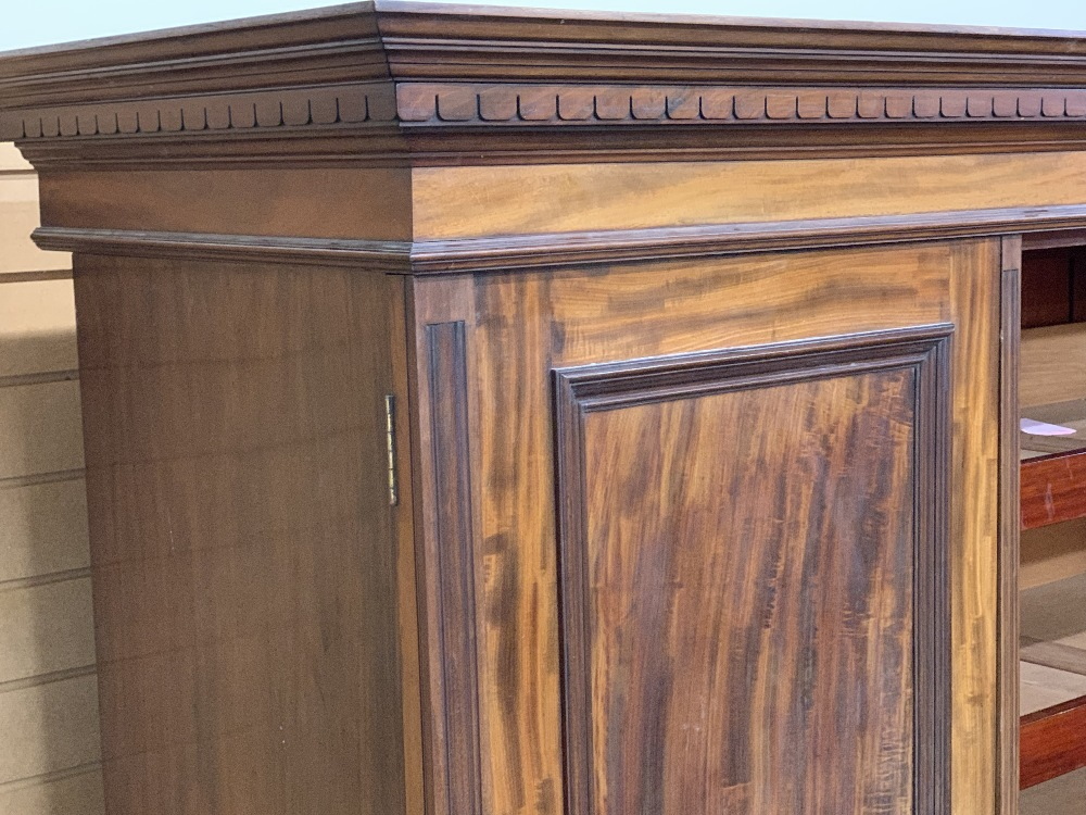 CIRCA 1900 MAHOGANY TRIPLE WARDROBE with dentil carved cornice and large central mirrored door - Image 4 of 6