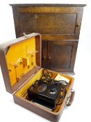 OAK MEDICINE TYPE CABINET and a cased Bakelite medical item by Juventus, 51cms H, 46.5cms W, 26cms D