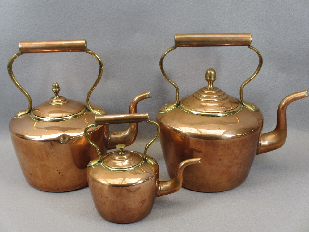 VICTORIAN COPPER KETTLES (3) - the two larger examples with acorn lid finials