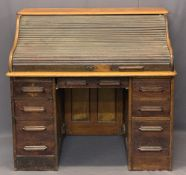 VINTAGE OAK ROLL TOP DESK - the tambour front opening to reveal interior drawers and pigeonholes