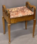 WALNUT BOX SEAT PIANO STOOL - having shaped sides on spindle gallery and tapering supports, 62cms H,