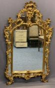 ROCOCO STYLE GILT FRAMED OVERMANTEL MIRROR - the pierced moulding having numerous mirrored panels
