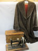 VINTAGE HAND CRANK SEWING MACHINE and a faux fur full length lady's coat, the sewing machine in a