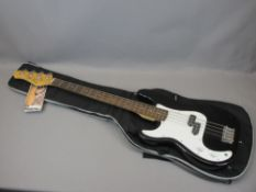 *MUSIC SHOP STOCK - J Turser left handed electric bass guitar with canvas carry case, 117cms L N.