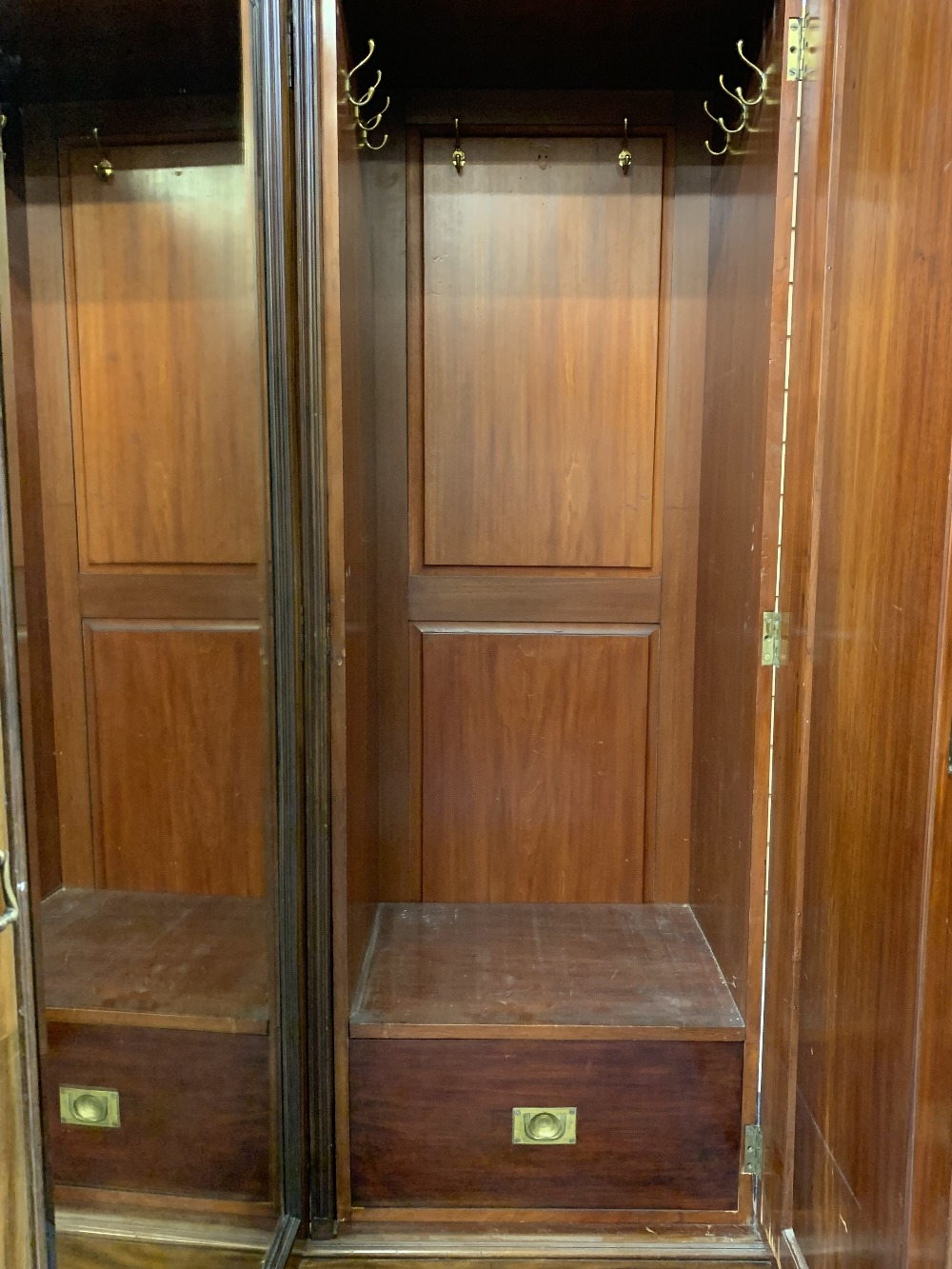 CIRCA 1900 MAHOGANY TRIPLE WARDROBE with dentil carved cornice and large central mirrored door - Image 3 of 6
