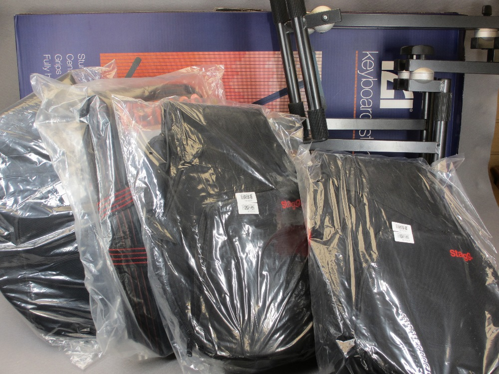 MUSIC SHOP STOCK - boxed and loose keyboard stands (2), canvas keyboard bag and three Stagg banjo