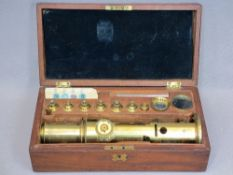 BRASS FIELD MICROSCOPE IN MAHOGANY CASE - fitted interior with additional lenses, bone slides,