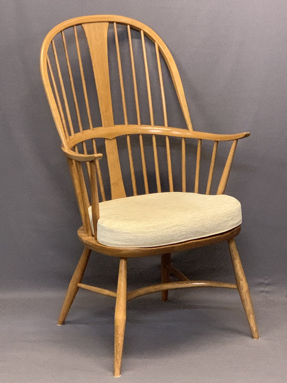 LIGHT ERCOL WINDSOR STYLE ARMCHAIR - with hoop back, crinoline type stretcher and removable