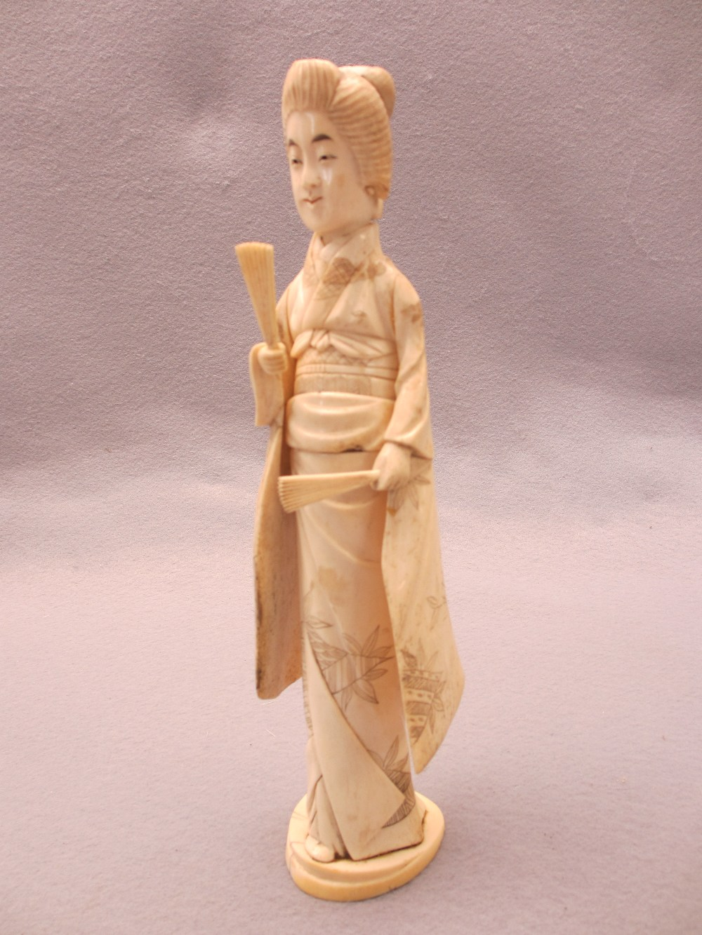 JAPANESE & OTHER IVORY & BONE OKIMONO, FOUR ITEMS - a standing sectional figurine of a Geisha girl - Image 2 of 5