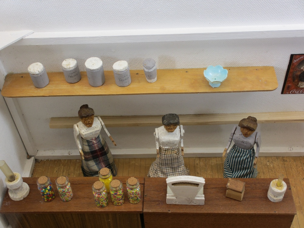 MID 20TH CENTURY FOLK ART MODEL OF A GROCER'S SHOP - complete with three carved ladies, boxes of - Image 2 of 4