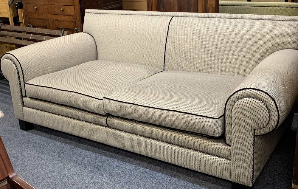 DURESTA ULTRA MODERN DESIGNER TYPE COUCH in black and grey with black piping and studded detail