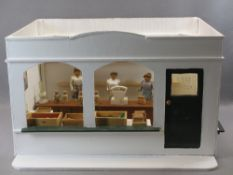 MID 20TH CENTURY FOLK ART MODEL OF A GROCER'S SHOP - complete with three carved ladies, boxes of