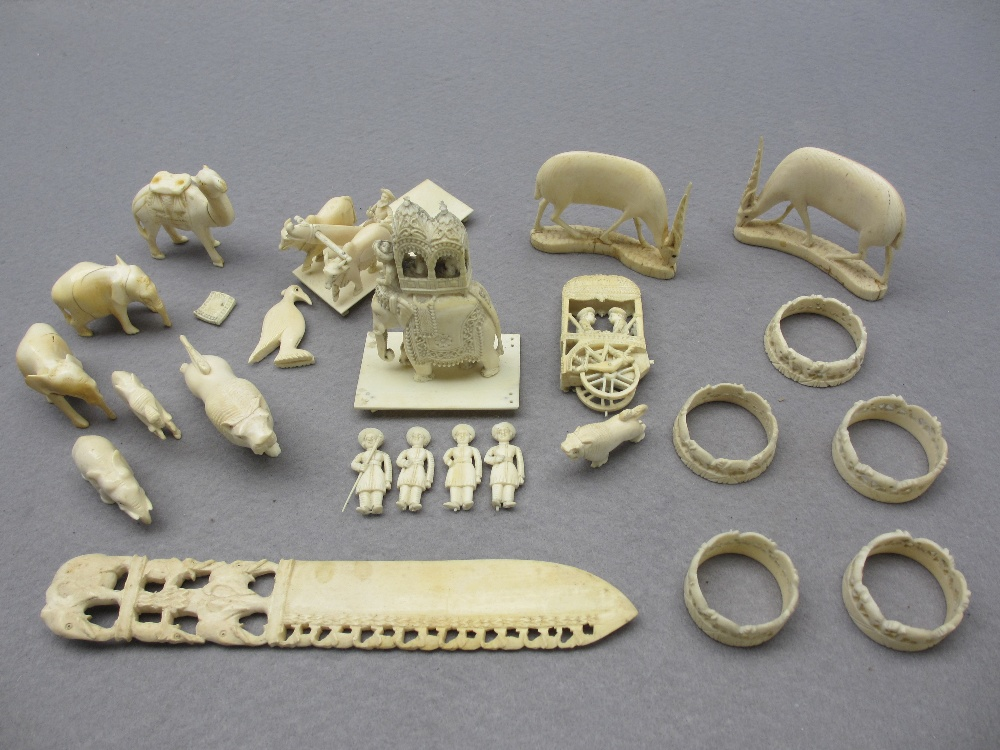 LATE 19TH/EARLY 20TH CENTURY ANGLO INDIAN IVORY/BONE CARVINGS - an elephant with palanquin on a