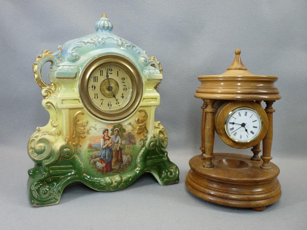 TURNED WALNUT DRUM CASED QUARTZ MANTEL CLOCK and a Victorian cheapware pottery mantel clock, 29