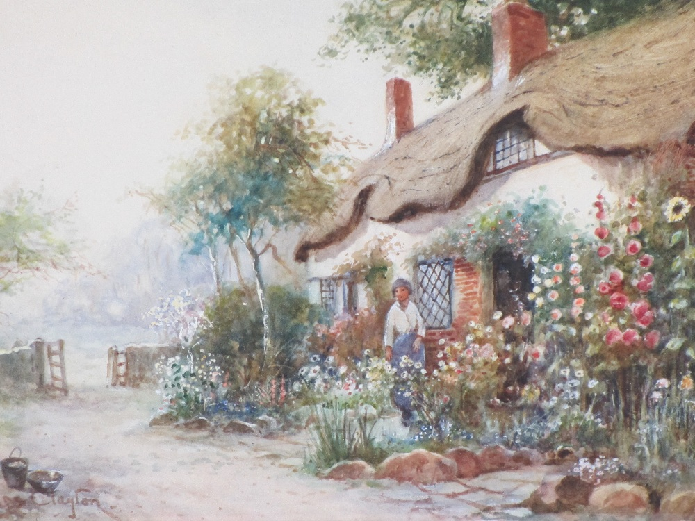 J HUGHES CLAYTON watercolour - thatched cottage with woman in the garden, signed lower left, 28 x