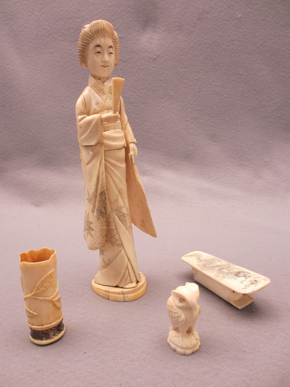 JAPANESE & OTHER IVORY & BONE OKIMONO, FOUR ITEMS - a standing sectional figurine of a Geisha girl