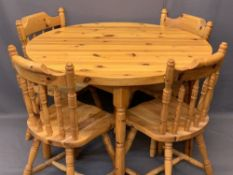 MODERN CIRCULAR TOP PINE TABLE & FOUR FARMHOUSE CHAIRS with turned spindle backs, 77cms H, 109cms