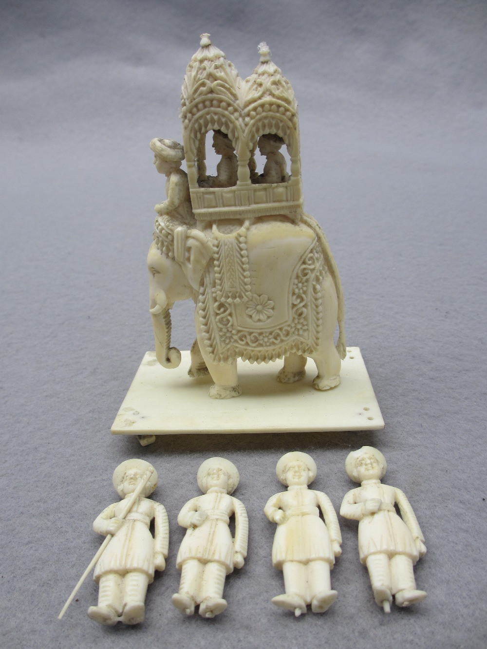 LATE 19TH/EARLY 20TH CENTURY ANGLO INDIAN IVORY/BONE CARVINGS - an elephant with palanquin on a - Image 2 of 5