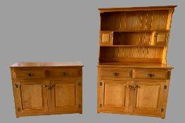 MODERN PINE DRESSER - the base with fielded panels and two drawers over two doors, with a two