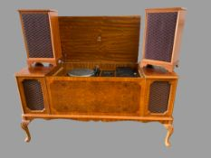 DYNATRON RADIOGRAM with a pair of floor standing speakers, in a walnut effect cabinet, 75cms H,