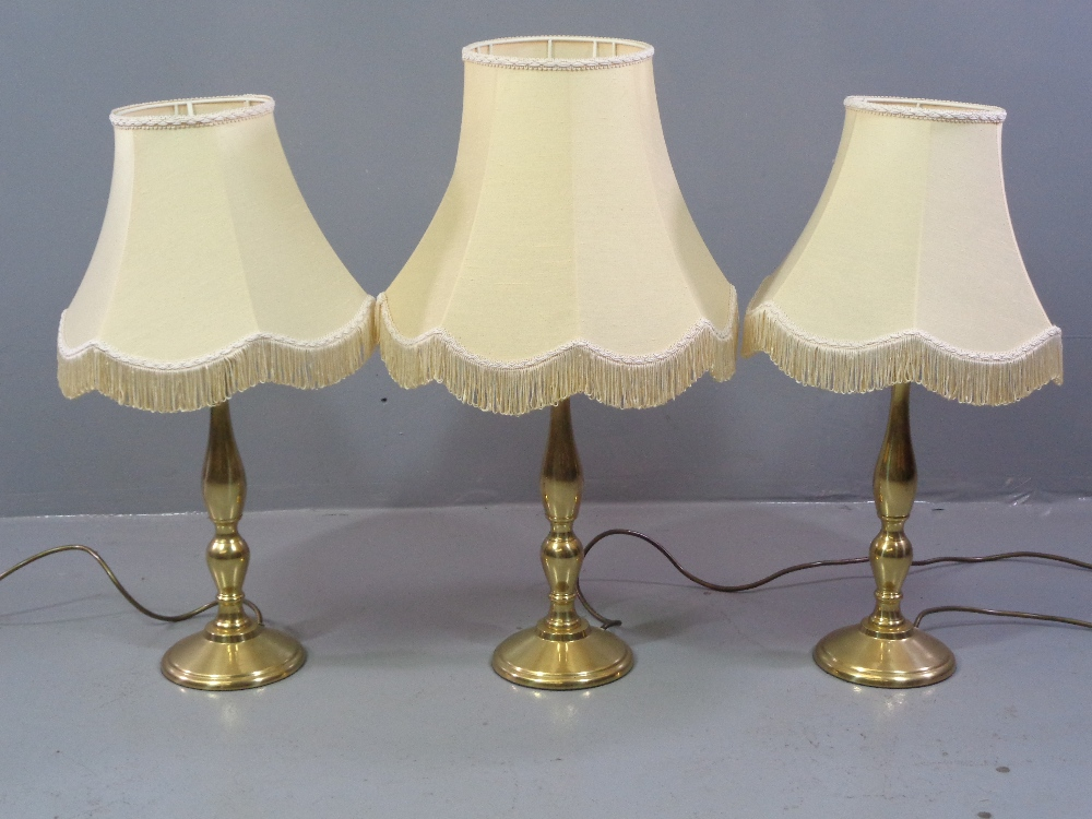 ORNATE TABLES LAMPS - five, three matching brass effect, 67cms H (with shades) and a pair of similar