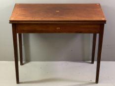 FOLDOVER CARD TABLE - circa 1830, mahogany with Sheraton style fan inlays and boxwood stringing,
