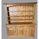 PINE DRESSER with a three shelf rack to the upper section and the base having three drawers over