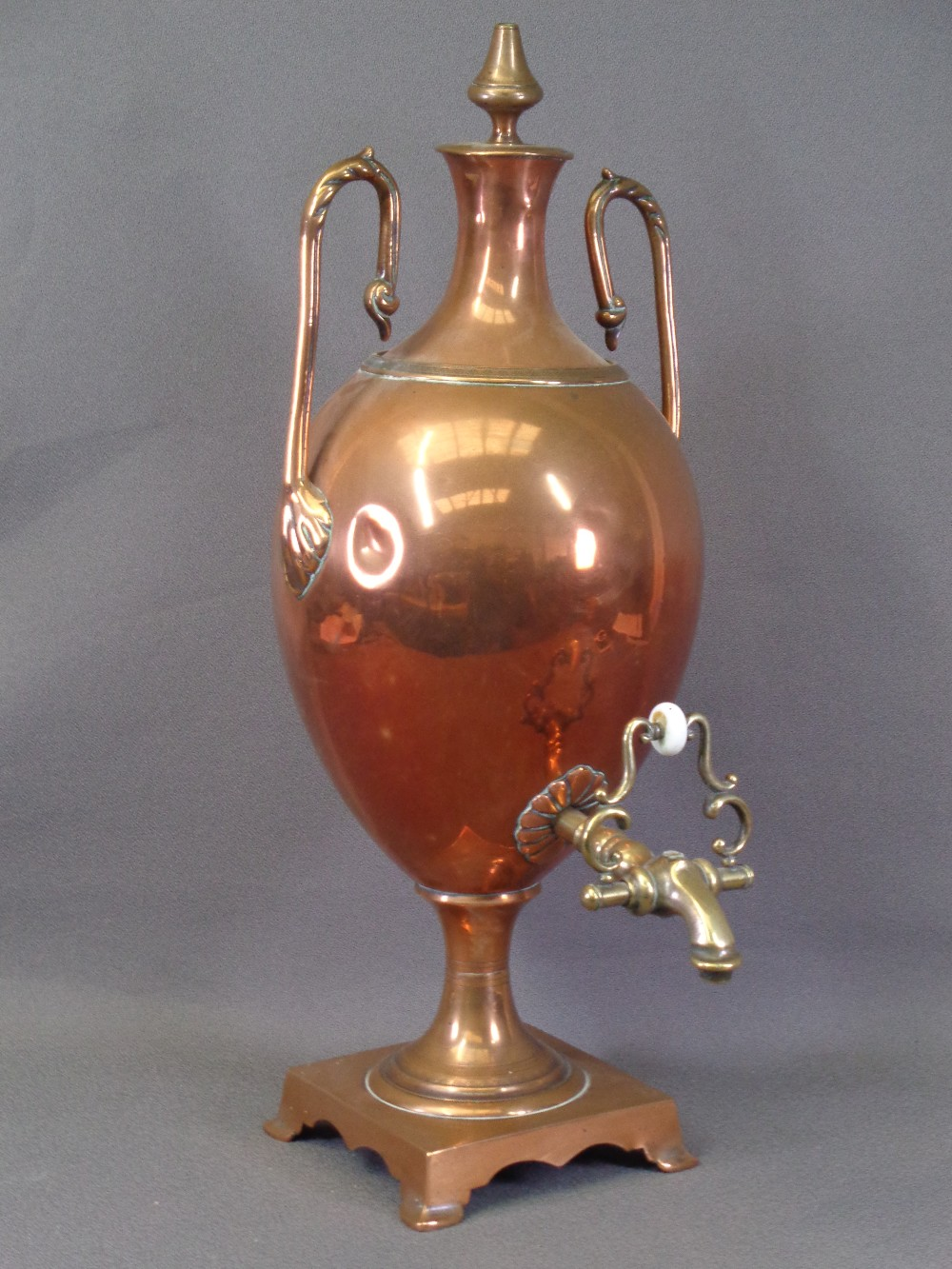 COPPER TEA URN - twin handled with a square base and brass tap, 55cms H
