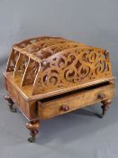 VICTORIAN CANTERBURY in walnut, three divisional fretwork sections with base drawer, on turned