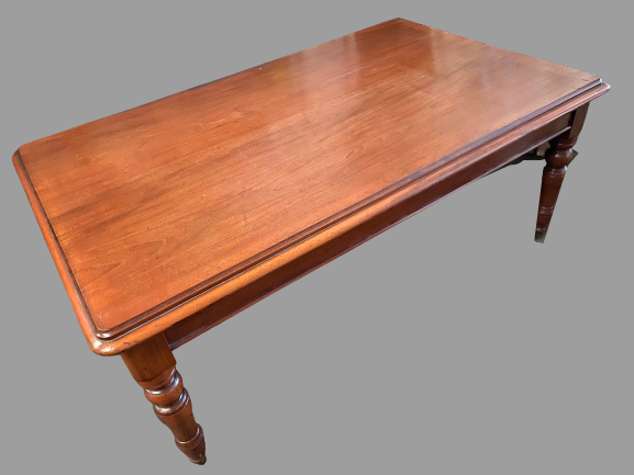 VICTORIAN DINING TABLE - oblong topped with turned corner supports on castors, 180 x 110cms