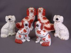 STAFFORDSHIRE COMFORTER DOGS, three pairs - smaller red and white pair with separate front legs,