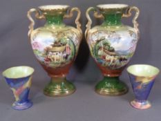 STAFFORDSHIRE VASES, a pair of twin handled, 43cms H, decorated Highland Cattle and a pair of Maling