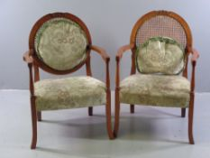 ORNATE ELBOW CHAIRS - a pair, walnut with cane backs