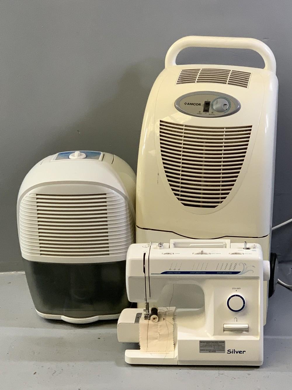 AMCOR TROLLEY DEHUMIDIFIER, a Delonghi portable dehumidifier and a modern electric sewing machine