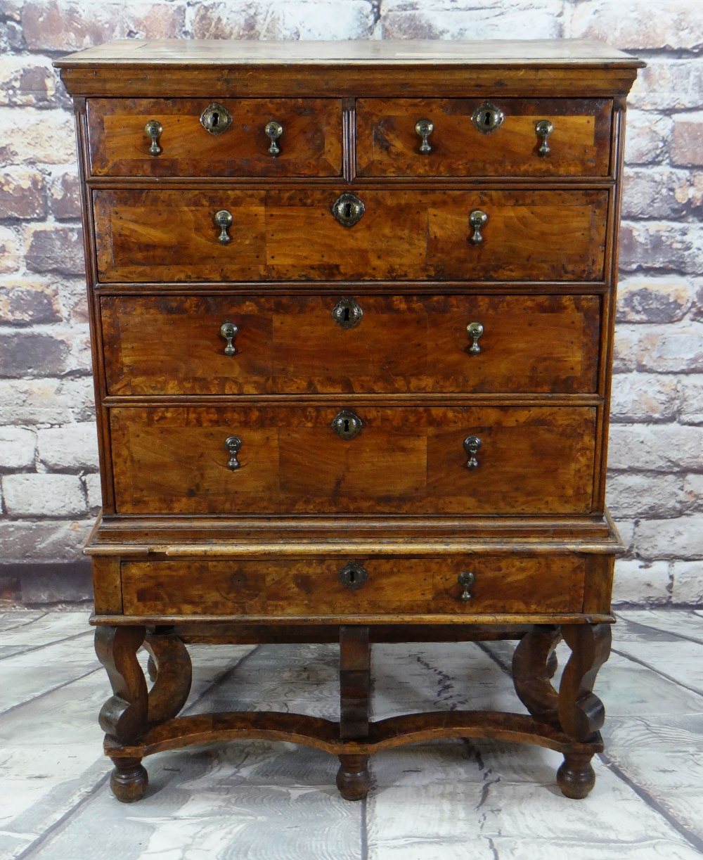 QUEEN ANNE WALNUT & BURR WALNUT CROSSBANDED CHEST ON STAND, veneered top and cornice above two short