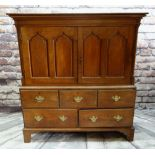 19TH CENTURY WELSH OAK PRESS CUPBOARD, shaped cornice above pointed arch panelled doors, on a