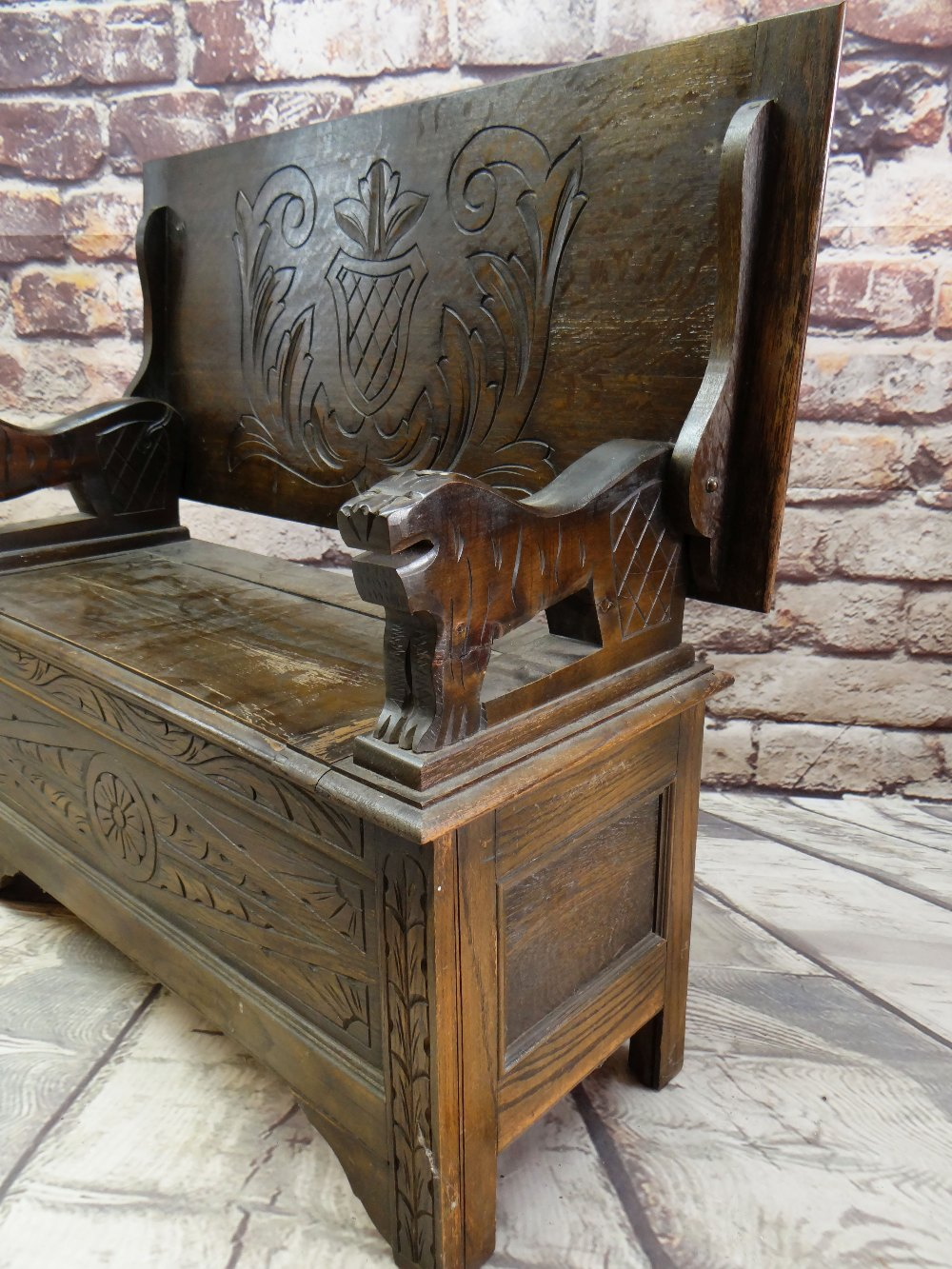 REPRODUCTION OAK MONK'S BENCH, lions carved arms and carved shiled top, 107cms wide - Image 2 of 5
