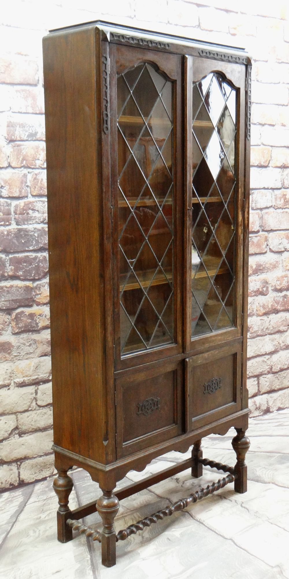 EARLY 20TH CENTURY CARVED OAK & LEADED GLASS BOOKCASE with applied mouldings, turned cup and cover - Image 2 of 2