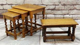 OAK OCCASIONAL TABLES comprising nest of three with barley twist legs and a low table or stool